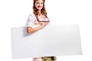 Woman in bavarian dress, studio shot, copy space