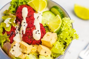 Vegan bowl with beetroot meatball