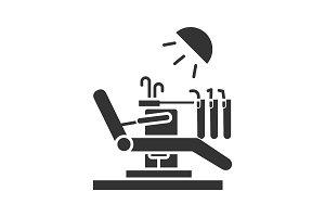 Dental chair glyph icon