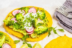 Pizza with broccoli and guacamole