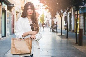 Beautiful woman buying in comercial