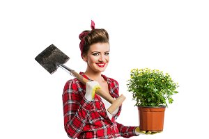 Pin-up girl holding flower pot with yellow daisies and spade