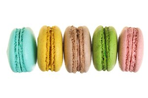 colored macaroons isolated on white background without a shadow closeup. Top view. Flat lay