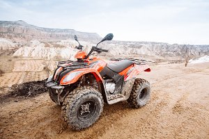 ATV Quad Bike in front of mountains