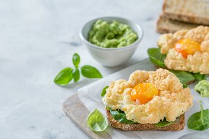 Trendy healthy eating concept - egg clouds on toasts