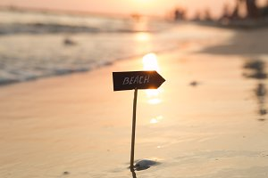 beach sign and sunset