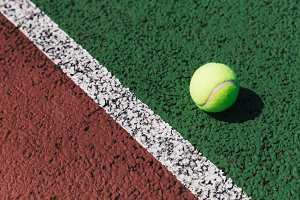Tennis ball on tennis court