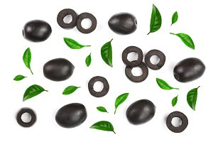whole and sliced black olives decorated with leaves isolated on white background. Top view. Flat lay pattern