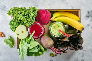 Alkaline diet concept - green and purple smoothies and ingredients
