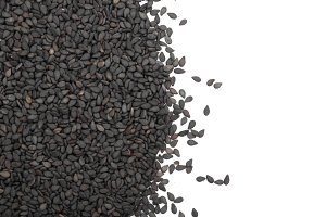 Black sesame seeds with copy space for your text isolated on white background top view