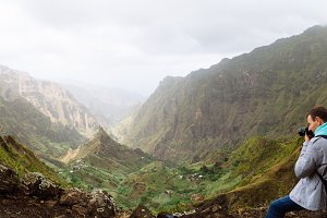 Traveler in front of motion landscape. Deep clouds above green Xo-Xo Valley. Santo Antao Island, Cape Verde