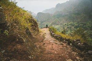 Male hiker enjoying impressive mountainscape. Lash canyon valley extend far below. Santo Antao, Cabo Verde