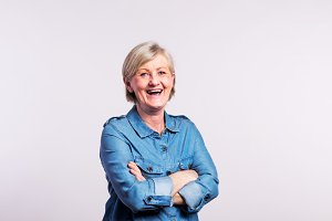 Portrait of a happy senior woman in studio, on a white background.