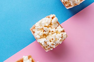 Popcorn  on blue and pink background
