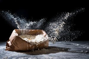 Bag with flour and flour splash