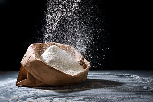 Bag with flour and sifting flour
