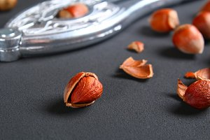 Top view of roasted peeled hazelnuts on a saturated black background.Snacks. Copy space.