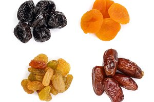Set of dried fruits isolated on white background. Top view. Flat lay