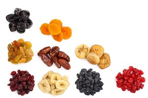 Set of dried fruits isolated on white background with copy space for your text. Top view. Flat lay