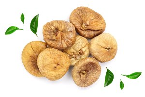 Dry figs decorated with green leaves isolated on white background, top view