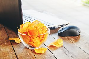 chips and a computer on the table.