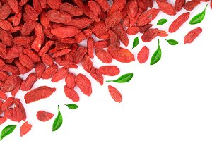 Dried goji berries decorated with green leaves Isolated on white background with copy space for your text