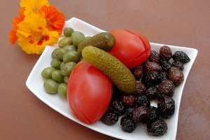 Olives, tomatoes, pickled cucumbers