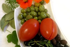 Olives and  pickled tomatoes on tray