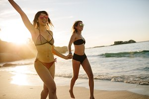 Women on the beach running