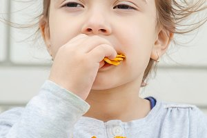 child eats chips. selective focus.