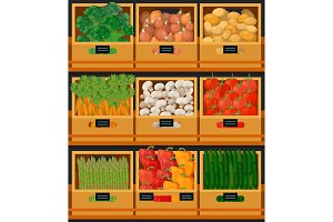 Vegetables at market in wooden boxes with prices