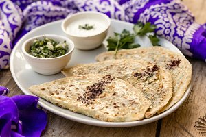 Azerbaijani traditional cuisine. Qutabs served with yogurt.
