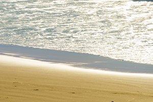Surfboard laying on ocean beach