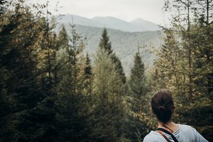 hipster traveler looking at mountain