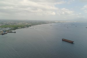 Cargo ships in the harbor. Batangas, Philippines