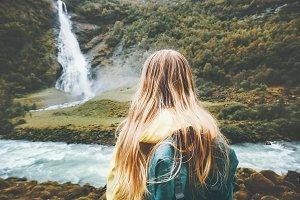Backpacker woman enjoying waterfall