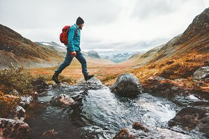 Man solo traveling backpacker hiking