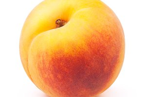 Fresh yellow peach isolated on white