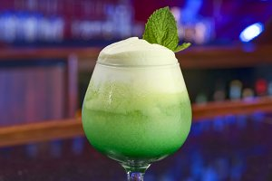 Green cocktail with foam