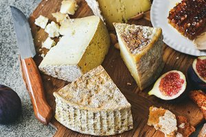 Cheese assortment, figs, honey, fresh bread and nuts