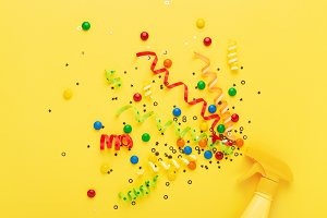 Conceptual party spray with confetti