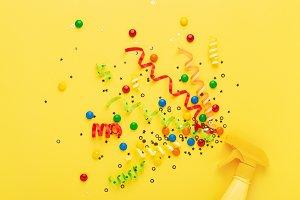 Conceptual party spray with confetti