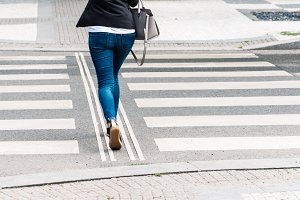 Young woman wearing casual clothes on zebra crossing