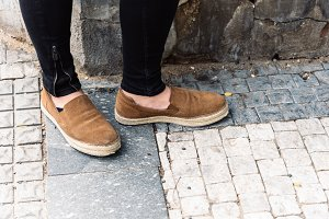 Low section of woman wearing shoes on street