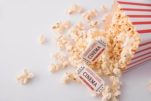 Movie tickets on popcorn top view