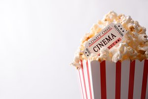 Movie tickets on bucket of popcorn