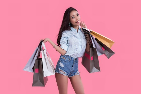 Happy Asian woman and shopping bag