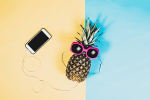 Pineapple with phone, summer
