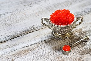 Salmon red caviar in silver bowl