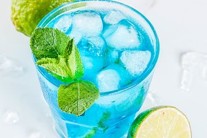 Iced blue alcohol cocktail